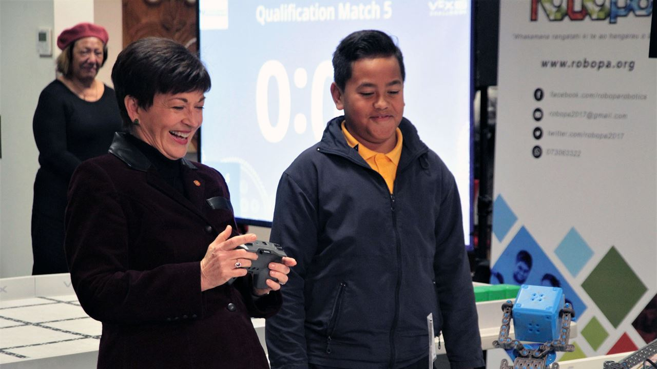 Dame Patsy Reddy tries her hand at robot scrimmage